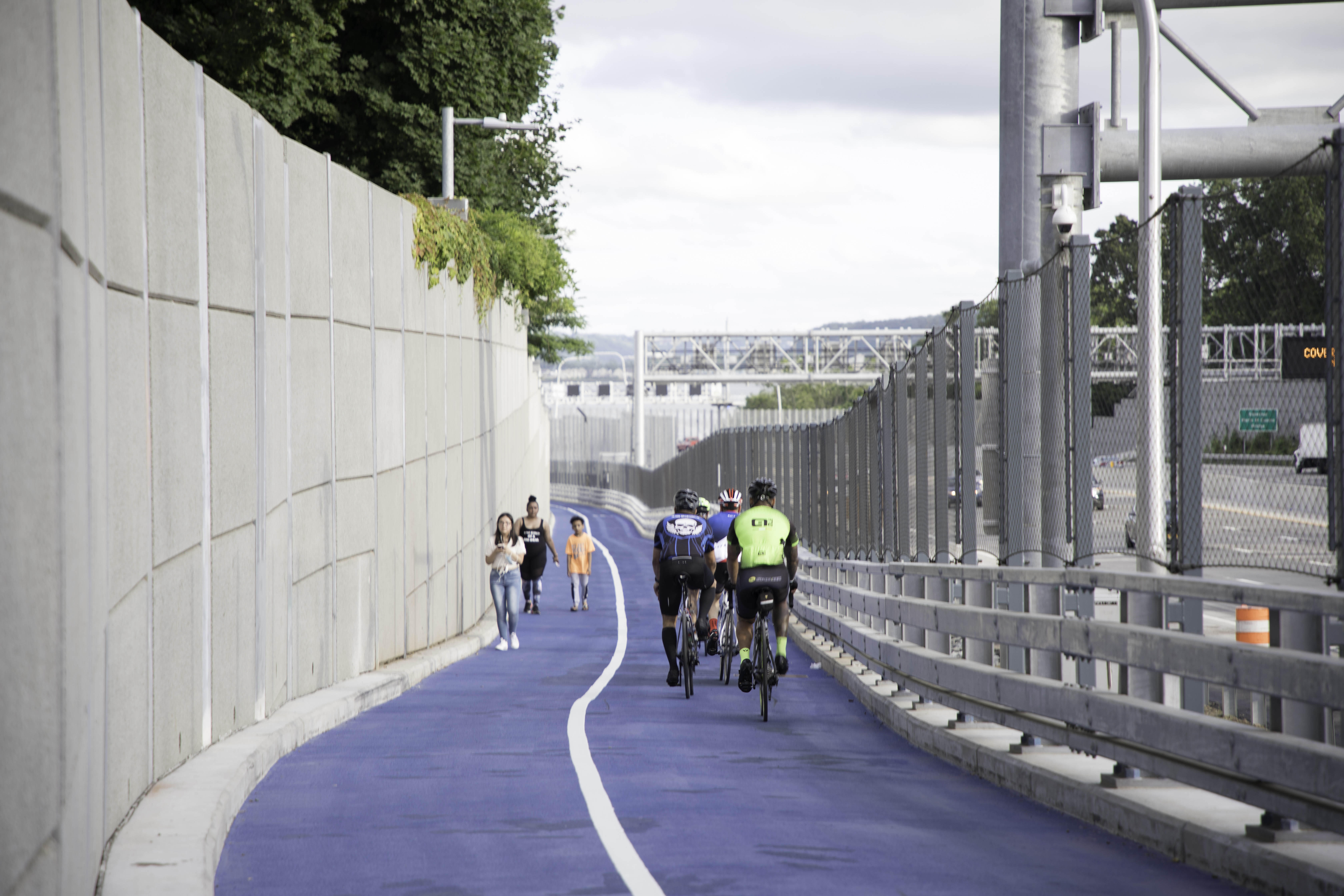 Cyclists and pedestrians on path